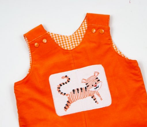 orange corduroy overalls with tiger