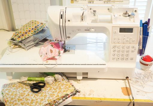 seamstresses sewing masks for healthcare workers
